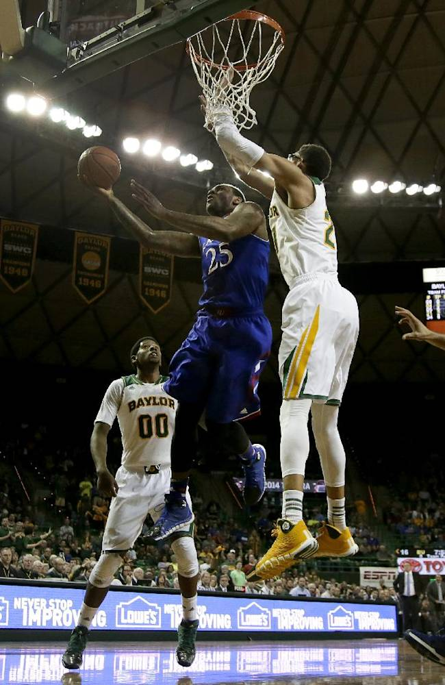 Kansas' Tarik Black (25) goes up for a shot as Baylor's Royce O'Neale and Isaiah Austin, right, defend in the first half of an NCAA college basketball game, Tuesday, Feb. 4, 2014, in Waco, Texas