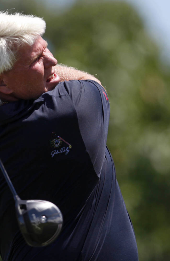 John Daly shoots a 12 on his way to a 90