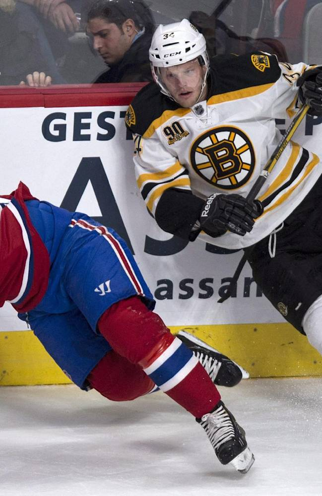 Montreal Canadiens' Max Pacioretty yells as he is checked by Boston Bruins' Carl Soderberg during first period NHL hockey action Wednesday, March 12, 2014 in Montreal