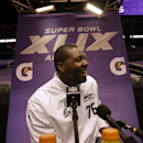 Seattle Seahawks' Russell Okung smiles during media day for NFL Super Bowl XLIX football game Tuesday, Jan. 27, 2015, in Phoenix The Associated Press