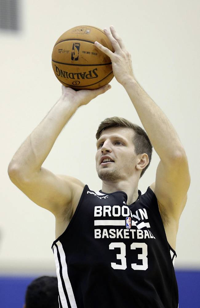 Brooklyn Nets' Mirza Teletovic shoots during NBA basketball training camp at Duke University in Durham, N.C., Wednesday, Oct. 2, 2013