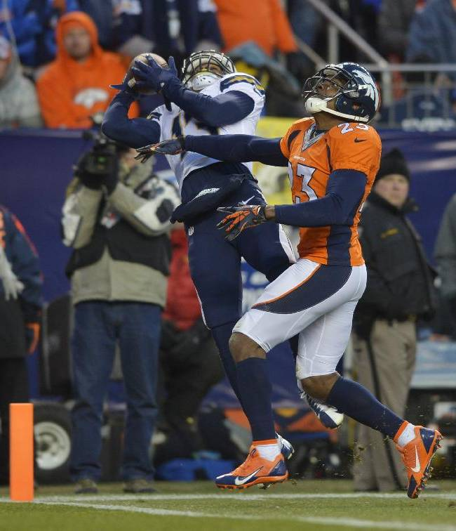 San Diego Chargers wide receiver Keenan Allen (13) catches a 16-yard touchdown pass against Denver Broncos cornerback Quentin Jammer (23) in the fourth quarter of an NFL AFC division playoff football game, Sunday, Jan. 12, 2014, in Denver