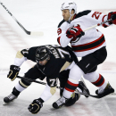 New Jersey Devils' Ryane Clowe (29) collides with Pittsburgh Penguins' Evgeni Malkin (71) in the first period of an NHL hockey game in Pittsburgh, Tuesday, Oct. 28, 2014 The Associated Press