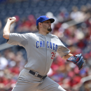 Cubs win 4-2, Hammel stays undefeated vs Nationals The Associated Press