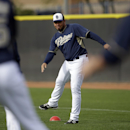 San Diego Padres' Joaquin Benoit stretches with teammates before a morning work out during baseball spring training Friday, Feb. 21, 2014, in Peoria, Ariz The Associated Press
