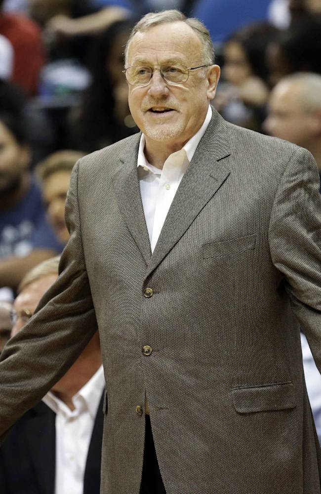 Minnesota Timberwolves head coach Rick Adelman disagrees with a call in the second half of an NBA preseason basketball game against the Toronto Raptors, Saturday, Oct. 12, 2013, in Minneapolis. The Raptors won 104-97