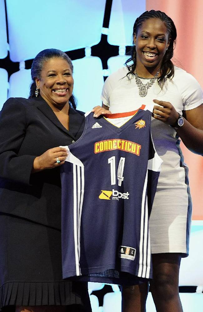 Duke's Chelsea Gray holds up a Connecticut Sun jersey with WNBA president Laurel J. Richie after Gray selected as the No. 11 pick in the WNBA basketball draft in, Monday, April 14, 2014, in Uncasville, Conn