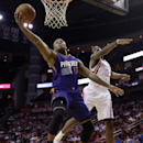 Phoenix Suns' P.J. Tucker (17) goes up for a basket as Houston Rockets' James Harden (13) defends during the first quarter of an NBA basketball game Wednesday, Dec. 4, 2013, in Houston The Associated Press