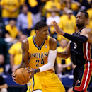 INDIANAPOLIS, IN - MAY 20: Paul George #24 of the Indiana Pacers looks to pass as Dwyane Wade #3 of the Miami Heat defends during Game Two of the Eastern Conference Finals of the 2014 NBA Playoffs at at Bankers Life Fieldhouse on May 20, 2014 in Indianapolis, Indiana. (Photo by Andy Lyons/Getty Images)