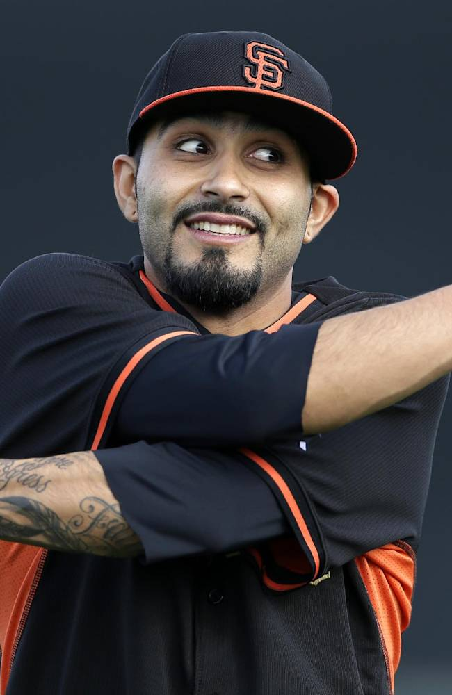 San Francisco Giants relief pitcher Sergio Romo stretches during spring training baseball practice on Sunday, Feb. 16, 2014, in Scottsdale, Ariz
