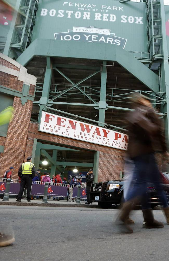 Fans make their way to Fenway Park before Game 1 of baseball's World Series between the Boston Red Sox and the St. Louis Cardinals Wednesday, Oct. 23, 2013, in Boston