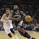 New Orleans Pelicans' Tyreke Evans (10 races around San Antonio Spurs' Marco Belinelli (3), of Italy, during the first half of an NBA basketball game, Monday, Nov. 25, 2013, in San Antonio The Associated Press