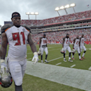 Tampa Bay Buccaneers defensive end Da'Quan Bowers (91) and leave the field during a weather warning in the second quarter of an NFL football game against the St. Louis Rams, Sunday, Sept. 14, 2014, in Tampa, Fla The Associated Press