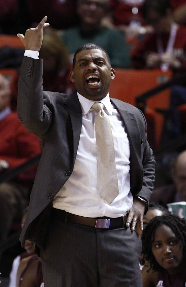 Maryland Eastern Shore head coach Fred Batchelor yells to his team as they play against Oklahoma during the second half of an NCAA women's college basketball game in Norman, Okla., Sunday, Dec. 15, 2013. Oklahoma won 105-46