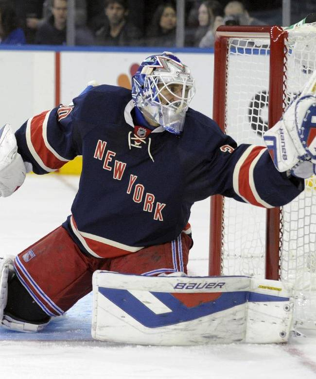 New York Rangers goaltender Henrik Lundquist, of Sweden, gloves the puck during the first period of an NHL hockey game against the Carolina Hurricanes on Saturday, Nov. 2, 2013, at Madison Square Garden in New York