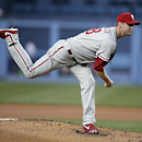 Philadelphia Phillies starting pitcher Kyle Kendrick watches a delivery to the Los Angeles Dodgers during the first inning of a baseball game Thursday, April 24, 2014, in Los Angeles The Associated Press