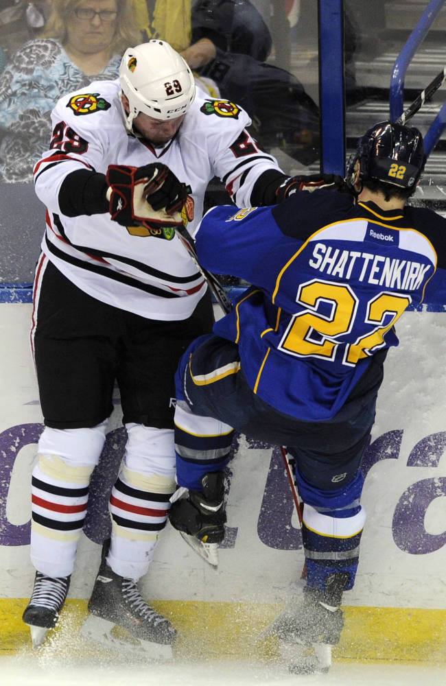 St. Louis Blues' Kevin Shattenkirk (22) collides with Chicago Blackhawks' Bryan Bickell (29) during the third period in Game 2 of a first-round NHL hockey playoff series, Saturday, April 19, 2014, in St. Louis