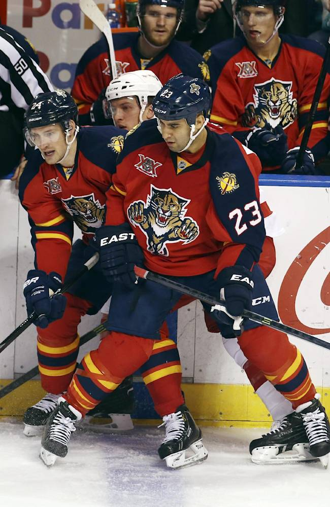 Florida Panthers players Scott Gomez (23) and Brad Boyes (24) block Detroit Red Wings' Luke Glendening (41) during the second period of an NHL hockey game in Sunrise, Fla., Thursday, Feb. 6, 2014