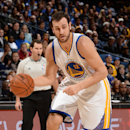OAKLAND, CA - DECEMBER 2: Andrew Bogut #12 of Golden State Warriors handles the ball against the Orlando Magic on December 2, 2014 at Oracle Arena in Oakland, California. (Photo by Noah Graham/NBAE via Getty Images)