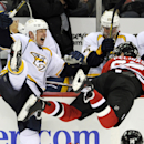 Nashville Predators' Matt Hendricks, left, is injured by the skate of New Jersey Devils' Eric Gelinas during the third period of an NHL hockey game Sunday, Nov. 10, 2013, in Newark, N.J. The Devils won 5-0 The Associated Press