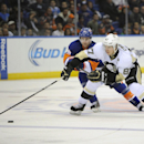 Pittsburgh Penguins' Sidney Crosby (87) drives the puck past Pierre-Marc Bouchard (96) in the third period of an NHL hockey game on Tuesday, Dec. 3, 2013, in Uniondale, N.Y. Crosby scored two goals during the Penguins 3-2 win in overtime The Associated Pr