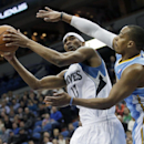 Minnesota Timberwolves' Corey Brewer, left, looks to shoot as Denver Nuggets' Randy Foye defends in the first quarter of an NBA basketball game Wednesday, Feb. 12, 2014, in Minneapolis The Associated Press