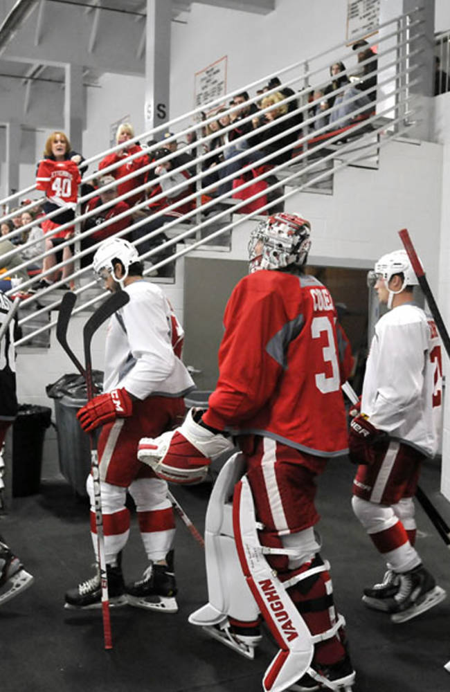 The Detroit Red Wings head to the ice during the NHL hockey training camp in Traverse City, Mich., Saturday, Sept. 14, 2013