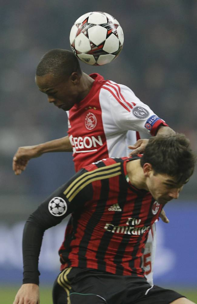 Ajax's Thulani Serero, heads the ball past AC Milan defender Mattia De Sciglio during a Champions League, Group H, soccer match, at the San Siro stadium, in Milan, Italy, Wednesday, Dec.11, 2013