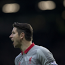 Liverpool's goalkeeper Brad Jones shouts to teammates during the English Premier League soccer match between Manchester United and Liverpool at Old Trafford Stadium, Manchester, England, Sunday Dec. 14, 2014