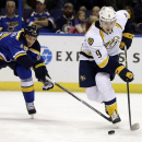 Nashville Predators' Filip Forsberg, of Sweden, controls the puck as St. Louis Blues' Jay Bouwmeester, left, defends during the first period of an NHL hockey game Thursday, Nov. 13, 2014, in St. Louis The Associated Press