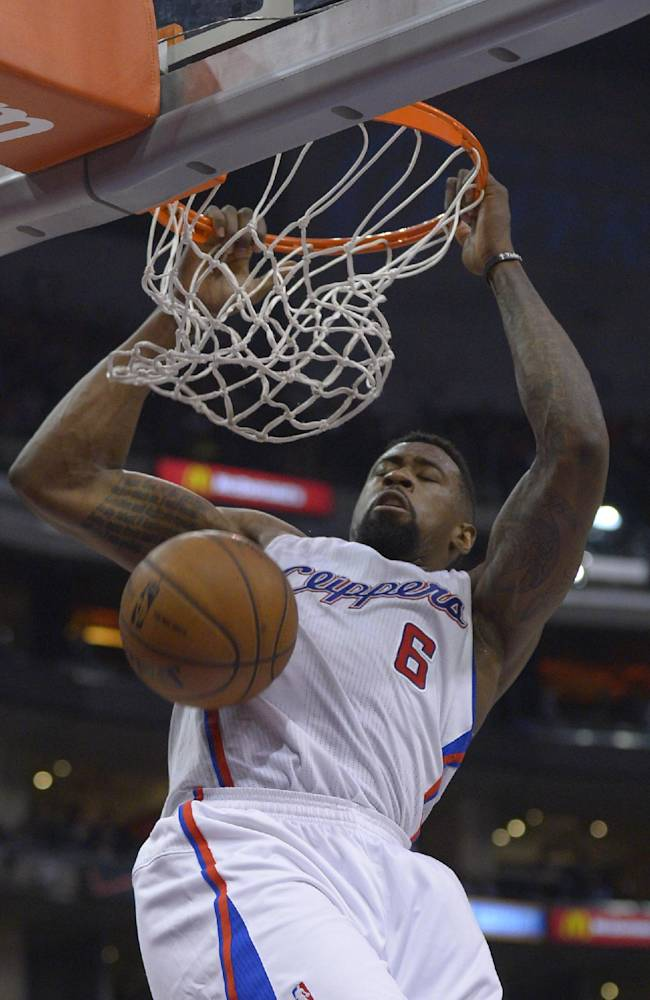 Los Angeles Clippers center DeAndre Jordan dunks during the first half of an NBA basketball game against the Washington Wizards, Wednesday, Jan. 29, 2014, in  Los Angeles