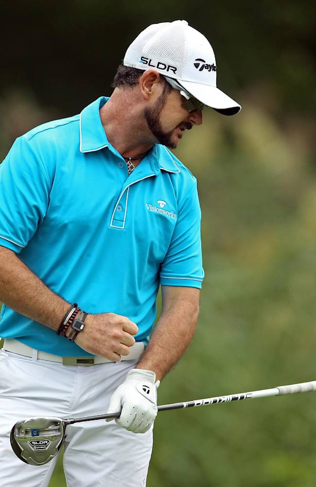 Rory Sabbatini, of South Africa, reacts to his tee shot on the fifth hole during second round play at The Barclays golf tournament Friday, Aug. 22, 2014, in Paramus, N.J