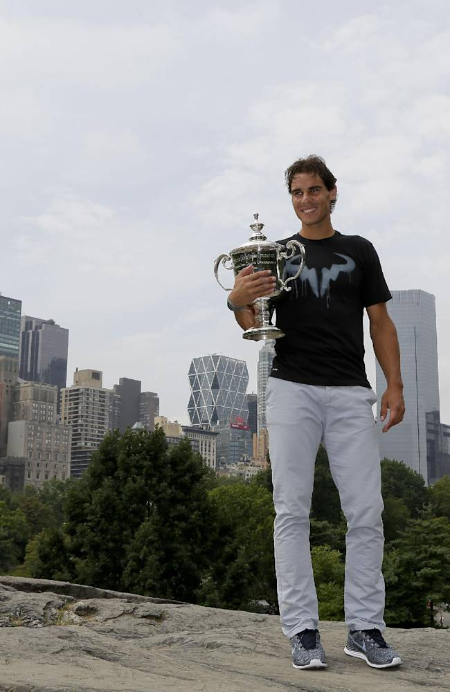 Rafael Nadal poses with the U.S. Open men's singles tennis tournament championship trophy at Central Park, Tuesday, Sept. 10, 2013, in New York. Nadal defeated Novak Djokovic in four sets on Monday