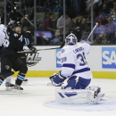 Tampa Bay Lightning goalie Anders Lindback, right, of Sweden, is beaten for a goal by San Jose Sharks' Tommy Wingels, not pictured, during the first period of an NHL hockey game on Thursday, Nov. 21, 2013, in San Jose, Calif The Associated Press