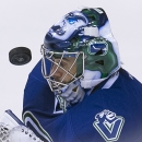 Vancouver Canucks goalie Ryan Miller (30) keeps his eye on the puck during the third period of an NHL hockey game, Saturday, Dec. 13, 2014 in Vancouver, British Columbia The Associated Press