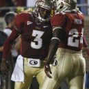 Florida State quarterback E.J. Manuel (3) and Florida State fullback Lonnie Pryor (24) celebrate Pryor's 13-yard touchdown during the first quarter of an NCAA college football game against Clemson on Saturday, Sept. 22, 2012, in Tallahassee, Fla. (AP Photo/Phil Sears)