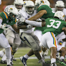 The Hawaii defense tries to pull down Nevada running back James Butler (20) in the third quarter of the NCAA college football game, Saturday, Oct. 25, 2014, in Honolulu. Nevada defeated Hawaii 26-18 The Associated Press