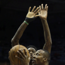 Houston Rockets' Dwight Howard, right, shoots against Milwaukee Bucks' Larry Sanders during the first half of an NBA basketball game, Saturday, Feb. 8, 2014, in Milwaukee The Associated Press