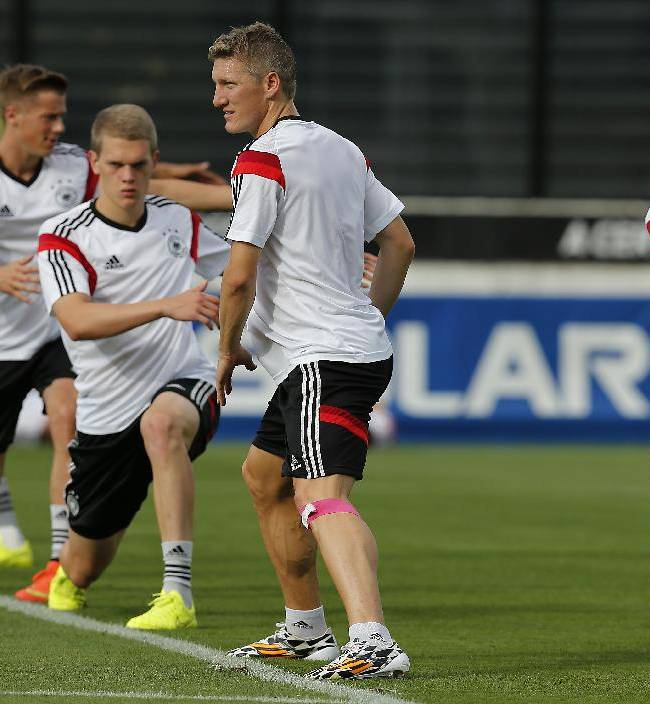 German players stretch during a training session of Germany in Rio de Janeiro, Brazil, Saturday, July 12, 2014. Germany faces Argentina for the 2014 soccer World Cup Final on Sunday