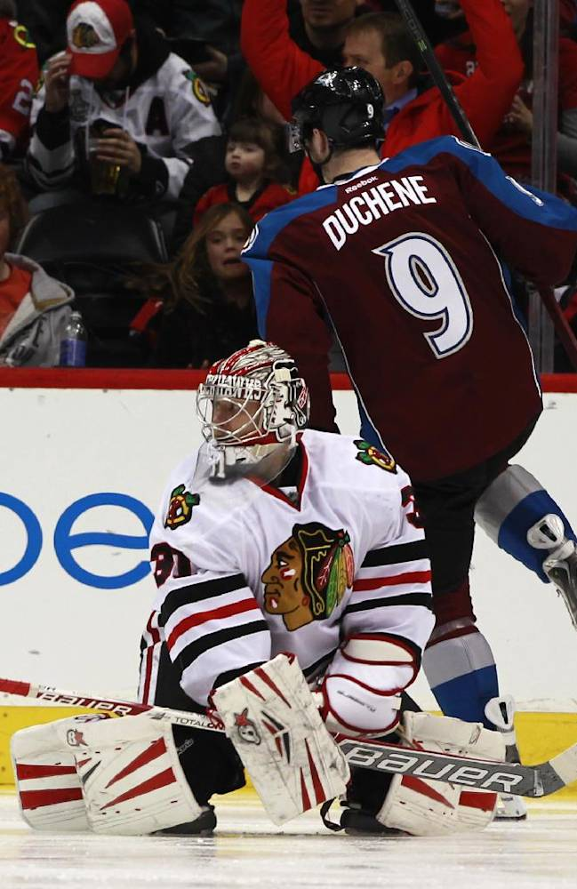 Chicago Blackhawks goalie Antti Raanta, front, of Finland, looks on after giving up a goal to Colorado Avalanche center Matt Duchene in the second period of an NHL hockey game in Denver on Wednesday, March 12, 2014