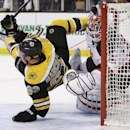 New Jersey Devils goalie Cory Schneider makes the save as Boston Bruins left wing Brad Marchand (63) flies through the crease during the second period of an NHL hockey game in Boston, Monday, Nov. 10, 2014 The Associated Press