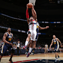 Bradley Beal #3 of the Washington Wizards dunks against Alec Burks #10 of the Utah Jazz during the game at the Verizon Center on March 5, 2014 in Washington, DC. (Photo by Ned Dishman/NBAE via Getty Images)