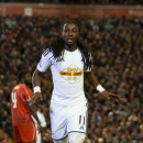 Swansea's Marvin Emnes celebrates after scoring against Liverpool during the English League Cup soccer match between Liverpool and Swansea at Anfield Stadium, Liverpool, England, Tuesday Oct. 28, 2014