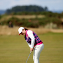South Korea's Inbee Park putts on the 9th green during the fourth round of the Women's British Open golf championship on the Old Course at St Andrews, Scotland, Sunday Aug. 4, 2013. (AP Photo/Scott Heppell)
