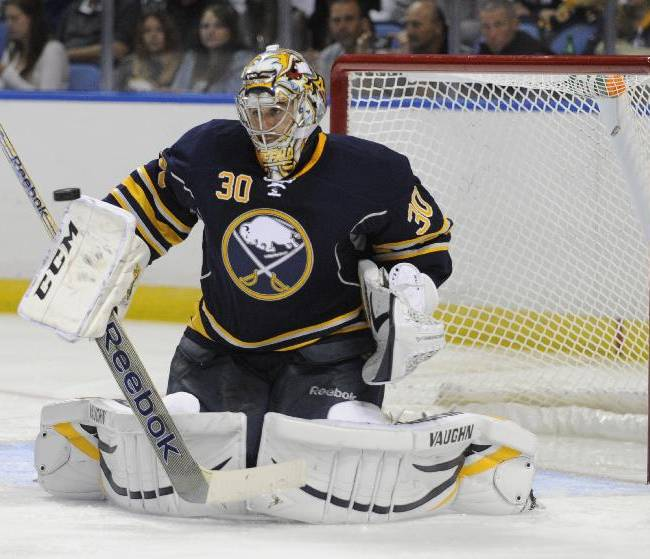 Buffalo Sabres goaltender Ryan Miller makes a save during the second period of an NHL hockey preseason game against the Carolina Hurricanes in Buffalo, N.Y., Thursday, Sept. 19, 2013