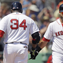 Boston Red Sox designated hitter David Ortiz (34) is greeted by Mike Napoli after Ortiz hit a homer in the third inning of an exhibition baseball game in Fort Myers, Fla., Monday, March 10, 2014 The Associated Press