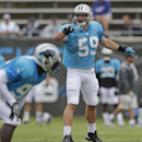 In this Aug. 1, 2014, file photo, Carolina Panthers' Luke Kuechly (59) directs the defense during an NFL football practice at their training camp in Spartanburg, S.C. The AP's Defensive Player of the Year in 2013, Kuechly is considered by Panthers coach R
