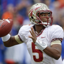 Florida State quarterback Jameis Winston looks for a receiver during the first half of an NCAA college football game against Florida in Gainesville, Fla., Saturday, Nov. 30, 2013.(AP Photo/John Raoux)