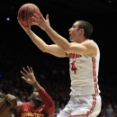Ohio State guard Aaron Craft (4) drives against Iowa State forward Anthony Booker (22) in the first half of a third-round game of the NCAA college basketball tournament Sunday March 24, 2013, in Dayton, Ohio. (AP Photo/Skip Peterson)