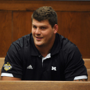 Tennessee Titans rookie NFL football player Taylor Lewan sits in Washtenaw County District Court in Ann Arbor, Mich., where he plead guilty to two misdemeanors to resolve an assualt case involving an Ohio State fan, Thursday, Oct. 30, 2014 The Associated